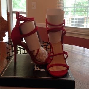 New red strapping heels with zipper at heel